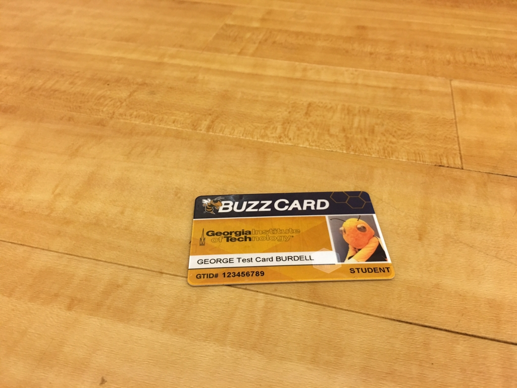 Lost BuzzCard pictured on hardwood floor